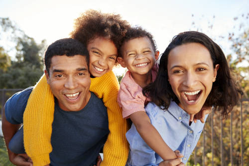 Happy family with results from their San Juan car accident case settlement.