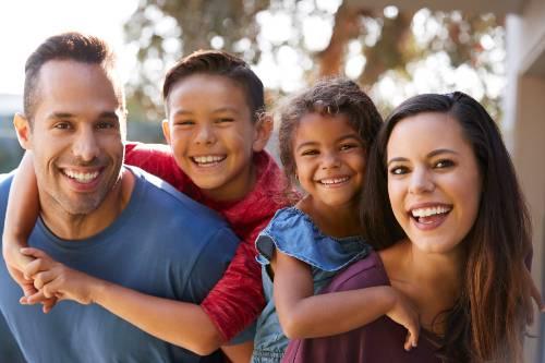 Smiling family in San Juan Capistrano.
